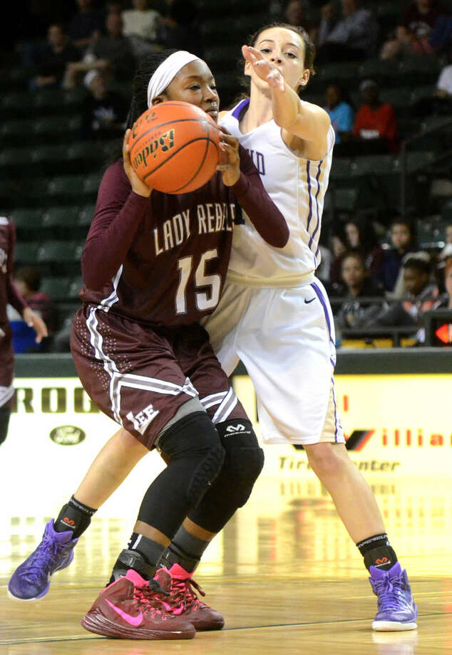 Midland High's Miranda Mast (11) covers Lee High's Bri'An Washington (15) on Tuesday, Jan. 20, 2015 at Chaparral Center. James Durbin/Reporter-Telegram Photo: James Durbin
