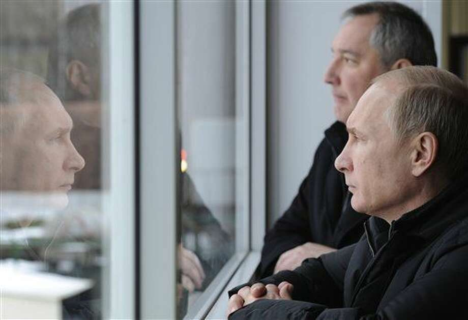 Russian President Vladimir Putin, right, visits the Central Scientific Research Institute of Precise Mechanical Engineering in Klimovsk, near Moscow, Russia, Tuesday, Jan. 20, 2015. At rear is Deputy Prime Minister Dmitry Rogozin. (AP Photo/RIA-Novosti, Mikhail Klimentyev, Presidential Press Service) Photo: Mikhail Klimentyev