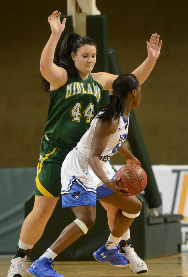Midland College's Lisa Kaempf (44) defends against Iowa Western's Blaire Thomas (42) on Friday, Nov. 20, 2015, at Chaparral Center. James Durbin/Reporter-Telegram Photo: James Durbin