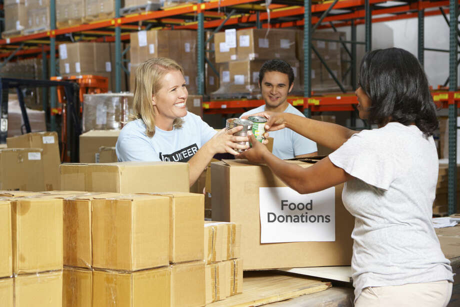 This file photo shows volunteers collecting food donations in a warehouse.  Photo: Monkeybusinessimages