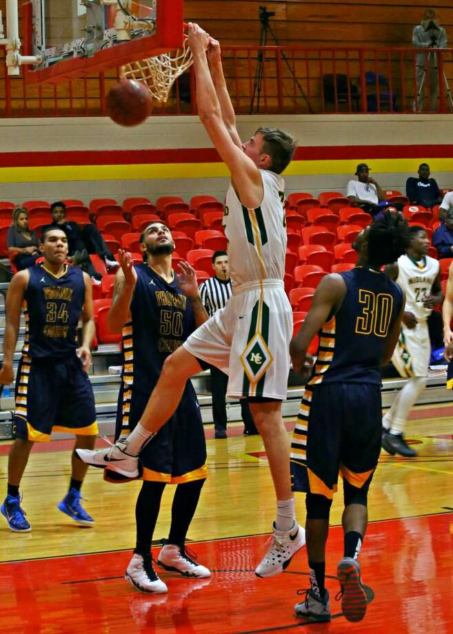 Midland College post Norbertas Giga slams versus Phoenix College at New Mexico Junior College's Caster Activity Center on Thursday. Nov 6. Photo: Forrest Allen|MC Athletics