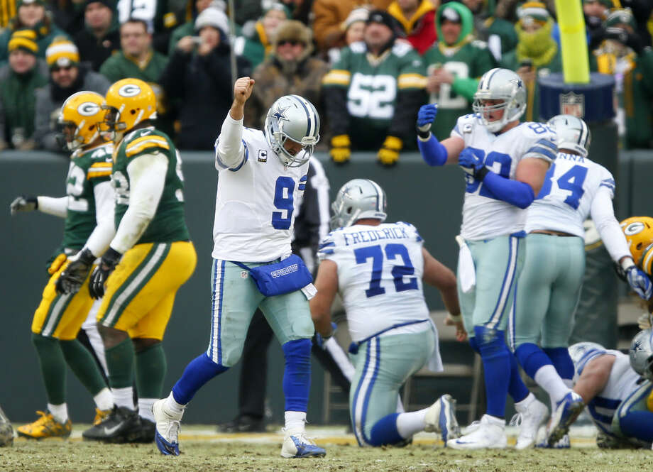 Dallas Cowboys quarterback Tony Romo (9) reacts to running back DeMarco Murray's third quarter touchdown in the NFC Divisional playoff at Lambeau Field in Green Bay Wisconsin, Sunday, January 11, 2015. The Cowboys lost 26-21. (Tom Fox/The Dallas Morning News) Photo: Tom Fox