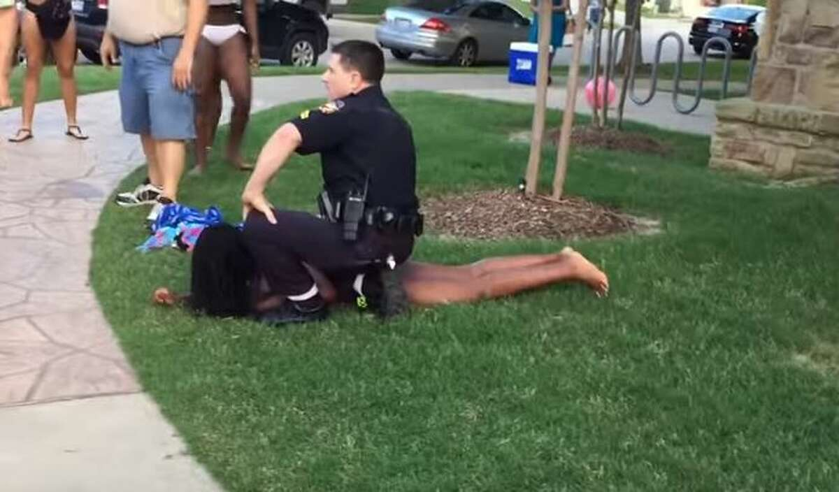 In this still frame from YouTube Cpl. Eric Casebolt is seen pinning down a 15-year-old teen.