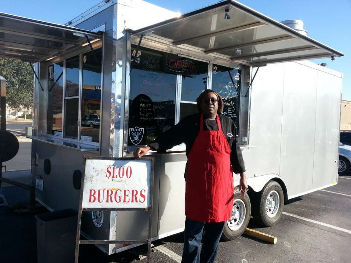 (File Photo) Todd Brown, owner of the Brown's BBQ food trailer, stands in front of his mobile kitchen in the Best Buy parking lot on Dec. 26, 2013. Brown is the head of a mobile food vendor association in Midland and hopes to start a food truck park in downtown Midland.
