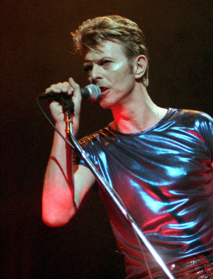 FILE - In this Sept. 14, 1995, file photo, David Bowie performs during a concert in Hartford, Conn. Bowie, the innovative and iconic singer whose illustrious career lasted five decades, died Monday, Jan. 11, 2016, after battling cancer for 18 months. He was 69. (AP Photo/Bob Child, File) Photo: BOB CHILD