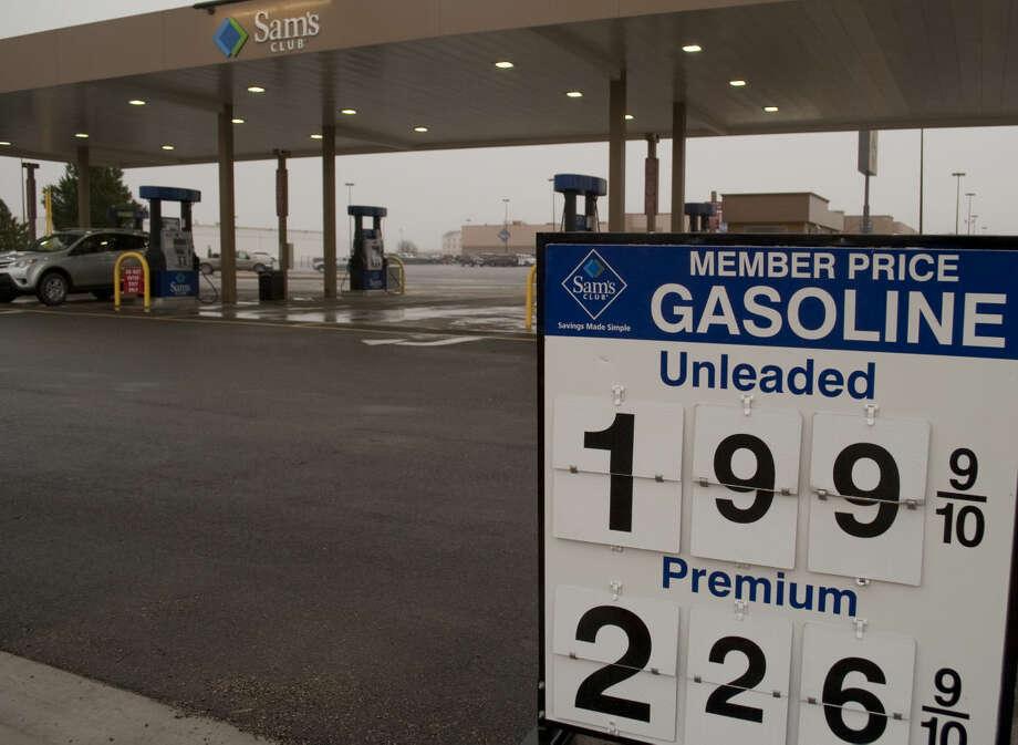 Gas prices fall below $2 a gallon Monday, 1-12-15, at the Sam's Club station. Tim Fischer\Reporter-Telegram Photo: Tim Fischer