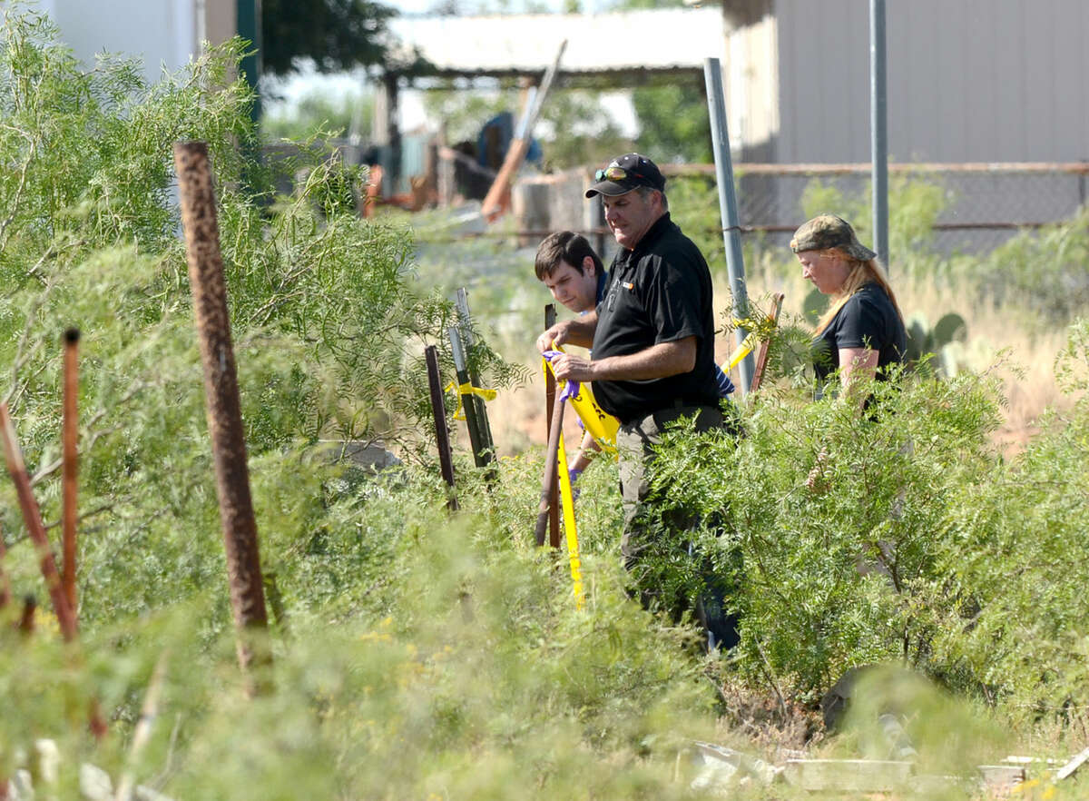 Midland public safety personnel work the area where the body of Amanda Hankins was found Thursday, June 11, 2015. James Durbin/Reporter-Telegram