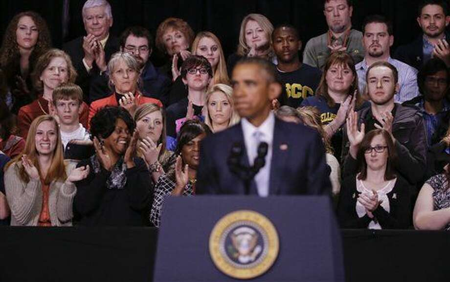 People applaud behind President Barack Obama as he pauses while speaking at Pellissippi State Community College Friday, Jan. 9, 2015, in Knoxville, Tenn. Obama is promoting a plan to make publicly funded community college available to all students. (AP Photo/Mark Humphrey) Photo: Mark Humphrey
