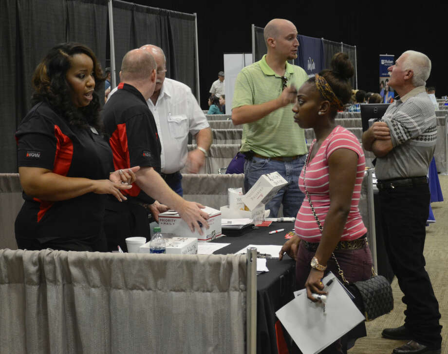 Employers talk with potential new employees Tuesday at the MRT Career Fair at the Midland Center. Tim Fischer\Reporter-Telegram Photo: Tim Fischer