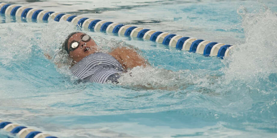 COM's Blythe Lary swims Friday in the girls 13 and over 100 m backstroke at the Western National Bank Invitational at Doug Russell Pool. Tim Fischer\Reporter-Telegram Photo: Tim Fischer