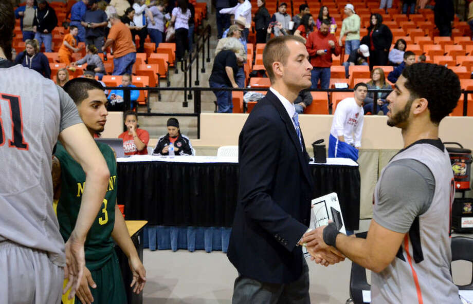 Midland College men's basketball head coach Jordan Dreiling shakes hands with Howard College players after the Chaparrals lost 77-61 on Thursday at Dorothy Garrett Coliseum in Big Spring. James Durbin/Reporter-Telegram Photo: JAMES DURBIN