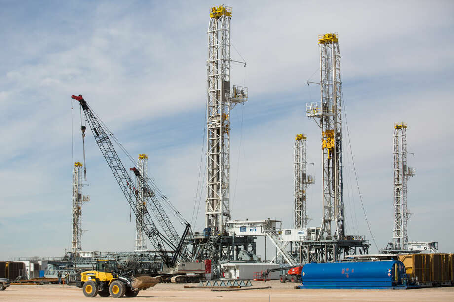 This photo shows a number of oil drilling rigs stacking in Helmerich & Payne International Drilling Company's yard in Ector County, Texas, Monday, Jan. 26, 2015. (AP Photo/Odessa American, Courtney Sacco) Photo: Courtney Sacco