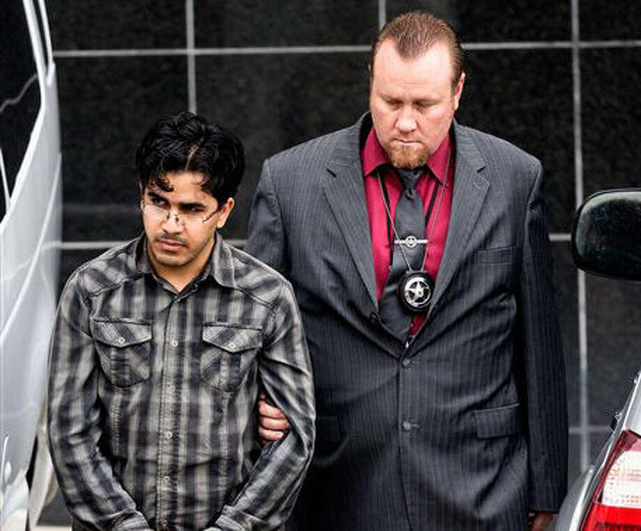 File - In this Jan. 8, 2016 file photo, Omar Faraj Saeed Al Hardan, left, is escorted by U.S. Marshals from the Bob Casey Federal Courthouse, in Houston. Al Hardan, who came to Houston from Iraq in 2009 is set to be arraigned Wednesday, Jan. 13, 2015, and have a bond hearing after his arrest on charges he tried to help the Islamic State group. (AP Photo/Bob Levey, File) Photo: Bob Levey