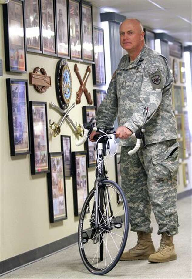 In this Jan. 14, 2014 photo, Sgt. Maj. Jerry W. Hochstedler poses with his bicycle at Fort Bliss, Texas. Hochstedler has always been an avid bicyclist, but he has rededicated himself to the sport since getting wounded. He cycles at least 250 miles a week and hopes one day to qualify for the Paralympics, an Olympic games for athletes with disabilities. (AP Photo/The El Paso Times, Mark Lambie) EL DIARIO OUT; JUAREZ MEXICO OUT; IF USE ON LAM OR LAT AND EL DIARIO DE EL PASO OUT Photo: Mark Lambie / The El Paso Times