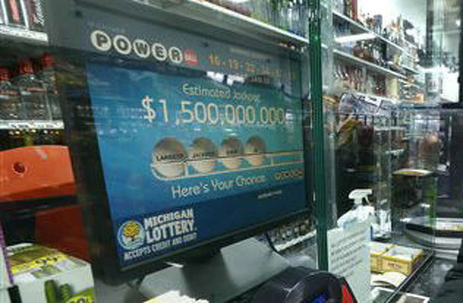 Tim Jackson buys Powerball tickets at Coach Liquor in Detroit, Wednesday, Jan. 13, 2016. A lottery official says the estimated Powerball jackpot will be over a billion. (AP Photo/Paul Sancya) Photo: Paul Sancya