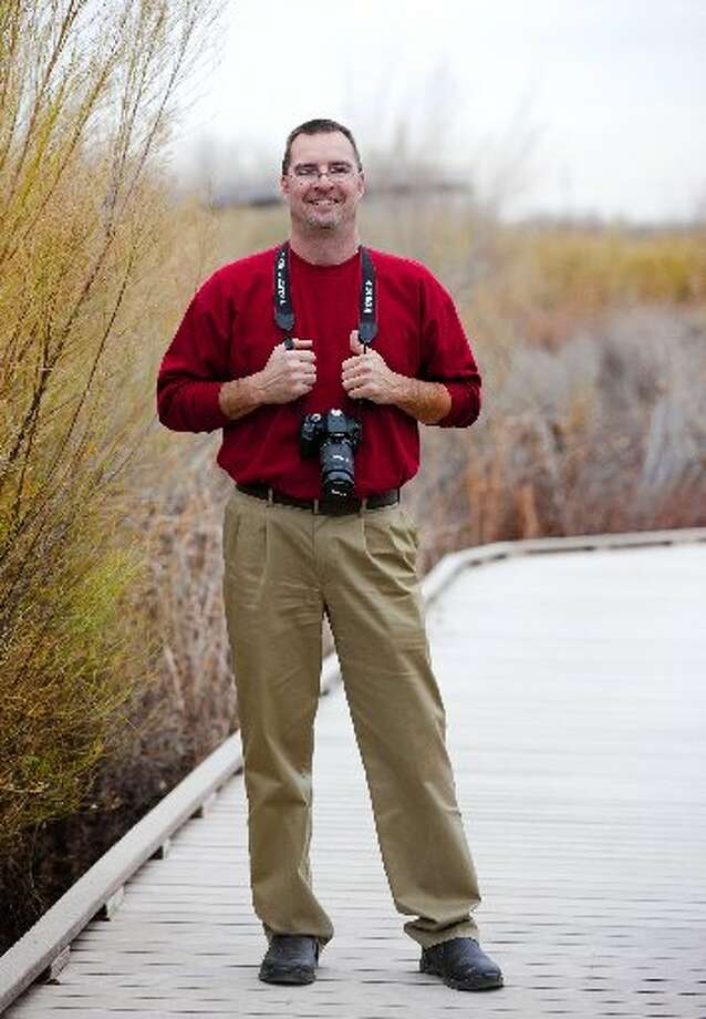 Michael Price, executive director of the I-20 Wildlife Preserve, poses for a photo Wednesday on the boardwalk at the Wildlife Preserve. Photo: James Durbin/Reporter-Telegram