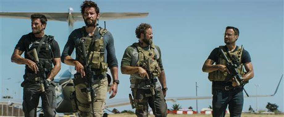"In this photo provided by Paramount Pictures shows Pablo Schreiber, from left, as Kris ""Tanto"" Paronto, John Krasinski as Jack Silva, David Denman as Dave ""Boon"" Benton and Dominic Fumusa as John ""Tig"" Tiegen, in the film, ""13 Hours: The Secret Soldiers of Benghazi"" from Paramount Pictures and 3 Arts Entertainment/Bay Films. The movie releases in U.S. theaters Jan. 15, 2016. (Christian Black/Paramount Pictures via AP) Photo: HONS"