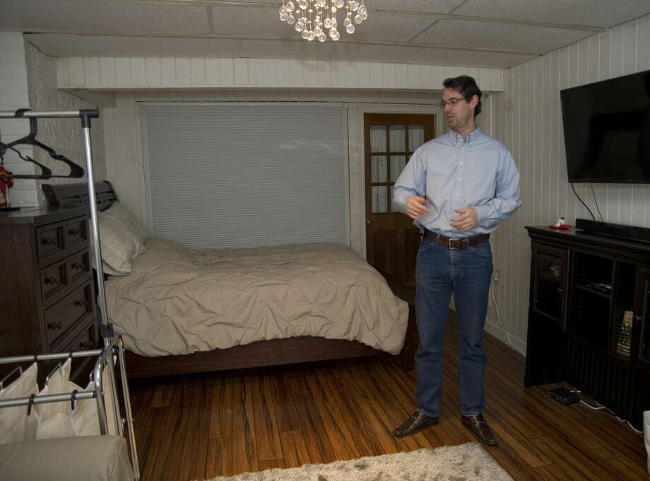 Edward McPherson shows off a room he converted into a fourth bedroom to rent out in his townhouse Friday 01-08-16. Tim Fischer\Reporter-Telegram Photo: Tim Fischer