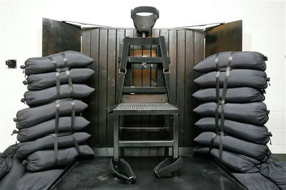 FILE - In this June 18, 2010, file photo, the firing squad execution chamber at the Utah State Prison in Draper, Utah, is shown. With lethal-injection drugs in short supply and new questions looming about their effectiveness, lawmakers in some death penalty states are considering bringing back relics of a more gruesome past, including firing squads. (AP Photo/Trent Nelson, Pool, File) Photo: Trent Nelson / POOL Salt Lake Tribune