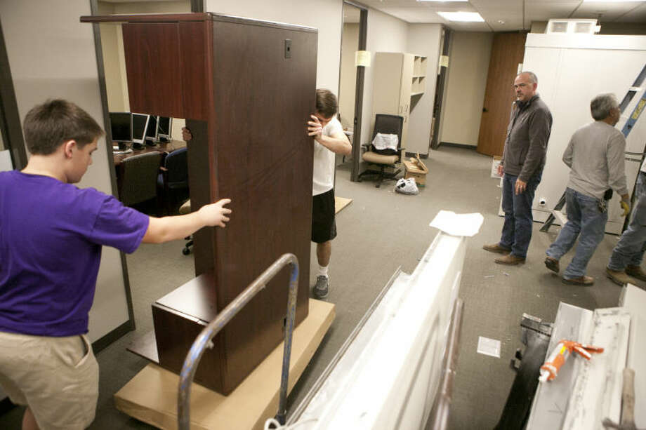Sam Palmer and Preston Palmer move a desk inside the Recording Library of West Texas offices Friday at the Shared Spaces building. James Durbin/Reporter-Telegram Photo: JAMES DURBIN