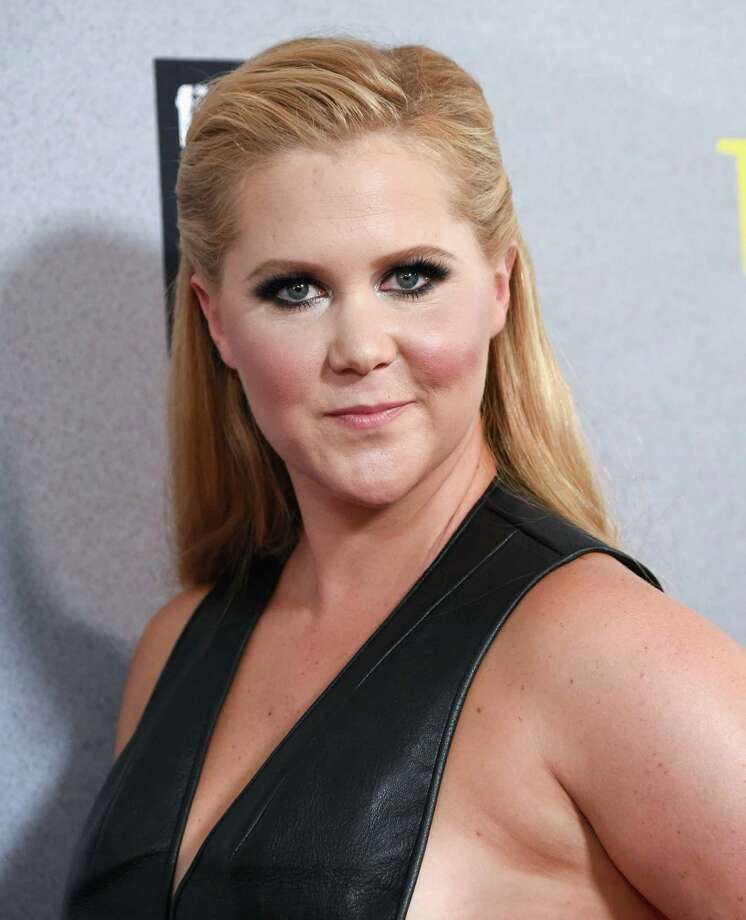 """FILE - In this July 14, 2015 file photo, actress Amy Schumer attends the world premiere of """"Trainwreck""""in New York. A representative for Jennifer Lawrence confirmed Wednesday, Aug. 26, that Lawrence and Schumer are writing a screenplay. In an interview with The New York Times, Lawrence said that the two are planning to star in the comedy as sisters. (Photo by Evan Agostini/Invision/AP, File) ORG XMIT: NYET324 Photo: Evan Agostini / Invision"""