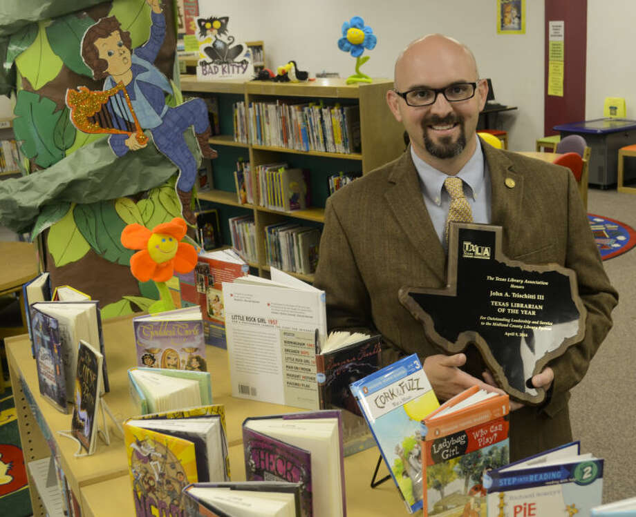 Midland County Librarian John Trischitti  won Texas Library Association's Librarian of the Year award in 2014. Tim Fischer\Reporter-Telegram Photo: Tim Fischer