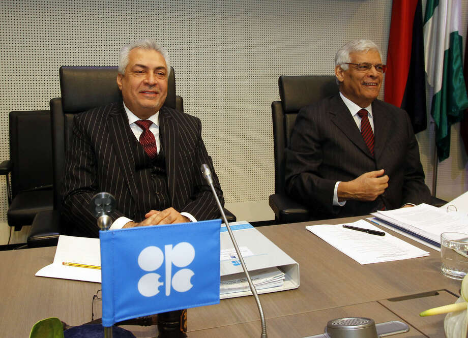 Iraq's Minister of oil and President of the Conference Abdul-Kareem Luaibi Bahedh. left. and the Secretary General of OPEC Abdalla Salem El-Badri of Libya, speak to journalists prior to the start of the meeting of the Organization of the Petroleum Exporting Countries, OPEC, at their headquarters in Vienna, Austria, Wednesday, Dec. 12, 2012 . (AP Photo/Ronald Zak) Photo: Ronald Zak