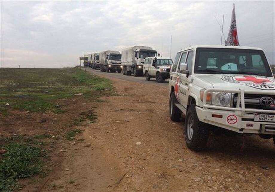 This picture provided by The International Committee of the Red Cross (ICRC), working alongside the Syrian Arab Red Crescent (SARC) and the United Nations (UN), shows a convoy containing food, medical items, blankets and other materials on its way to the towns of Foua and Kfarya in northern Syria, Monday, Jan. 11, 2016. Both towns are under siege by rebels seeking to oust President Bashar Assad. (ICRC via AP) Photo: Uncredited