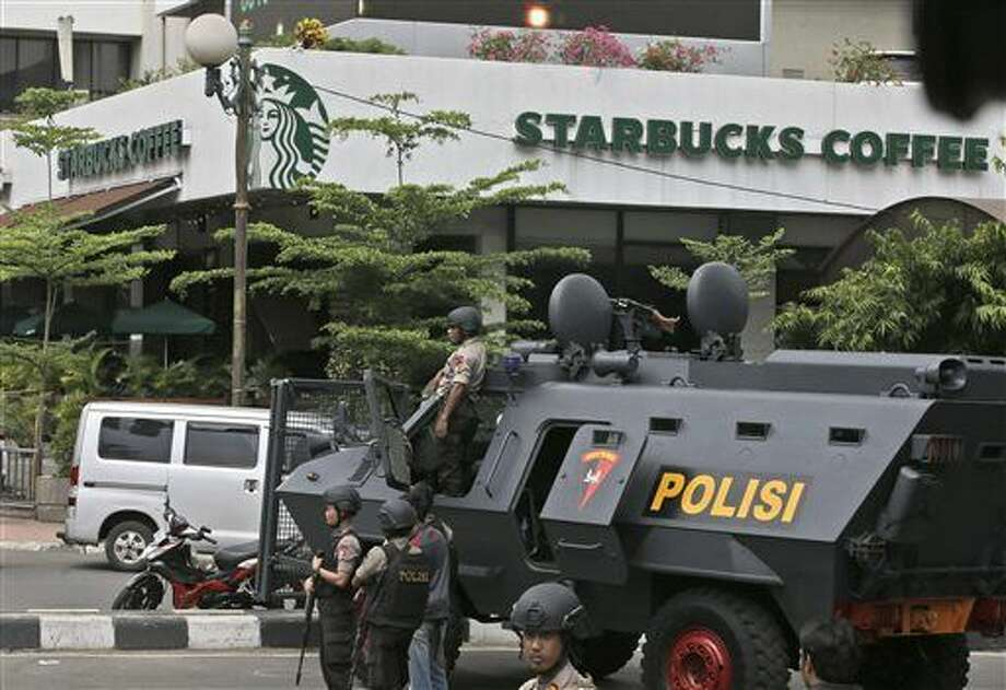 A police armored vehicle is parked outside a Starbucks cafe after an explosion in Jakarta, Indonesia Thursday, Jan. 14, 2016. Attackers set off explosions at a Starbucks cafe in a bustling shopping area in Indonesia's capital and waged gunbattles with police Thursday, leaving bodies in the streets as office workers watched in terror from high-rise buildings. (AP Photo/Achmad Ibrahim) Photo: Achmad Ibrahim