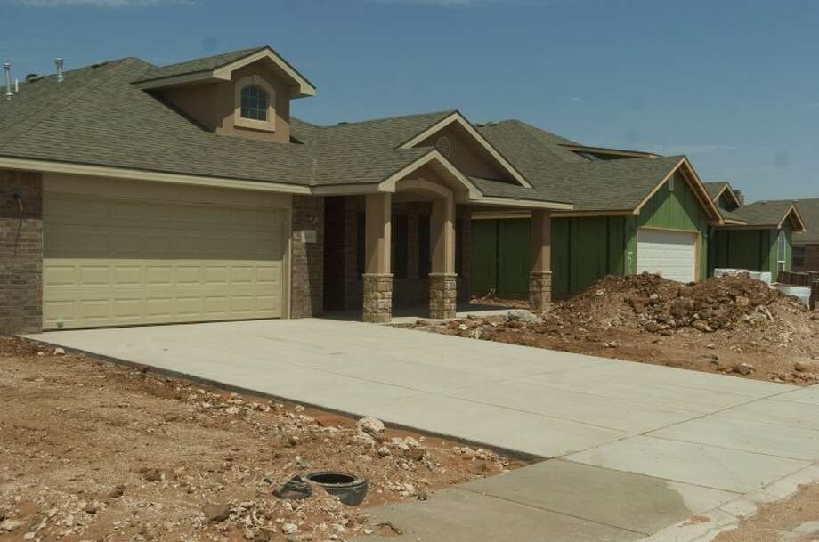 (File Photo) New homes being built by Betenbough Homes in the new Legends Park community near the stadium complex. Photo by Tim Fischer/Midland Reporter-Telegram Photo: Tim Fischer