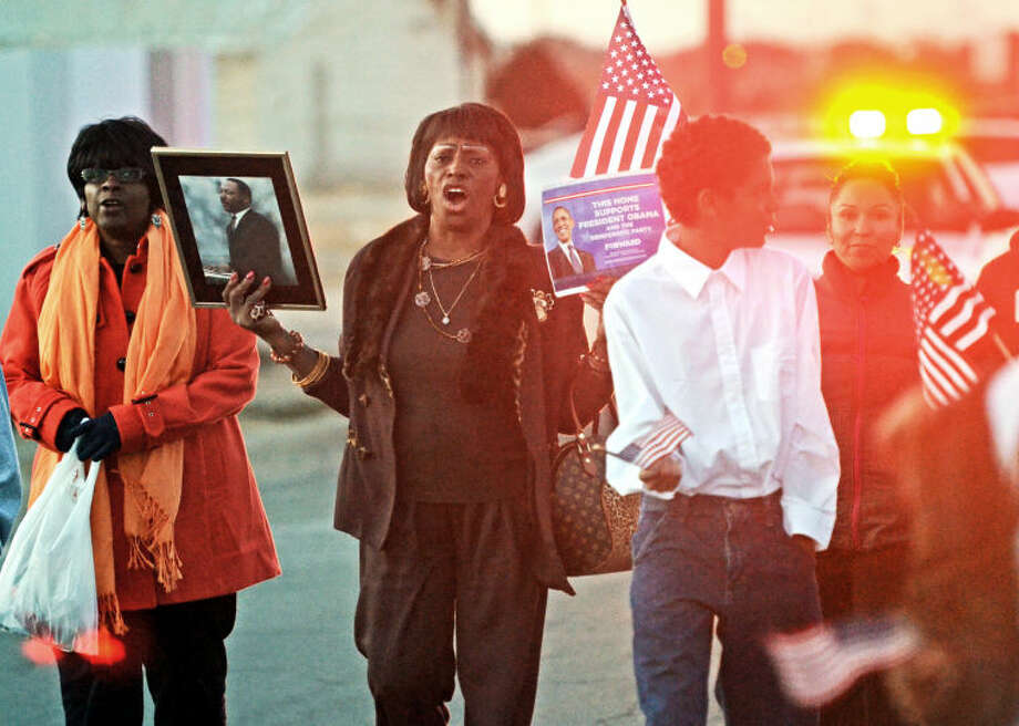 Irma Maulmontri walks down Butternut Lane during a symbolic march from Mt. Carmel Baptist Church to Lee Freshman High School Monday in honor of Martin Luther King, Jr. Day. Maulmontri is a teacher at the Day By Day Learning Center where she says tries to inspire children by the example of Martin Luther King, Jr. James Durbin/Reporter-Telegram Photo: JAMES DURBIN