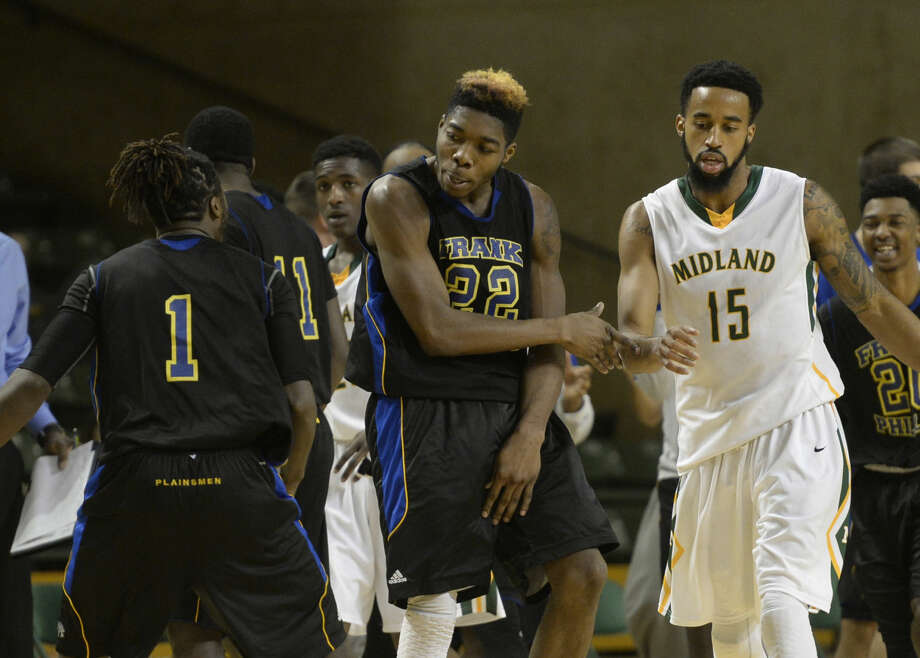 Frank Phillips College's Lucious McKay (1) and Isaiah Palmer (22) celebrate as they lead Midland College going into a time out in the final minutes of play Thursday, Jan. 14, 2016, at Chaparral Center. Midland's Solomon Hainna (15) walks off the court. James Durbin/Reporter-Telegram Photo: James Durbin