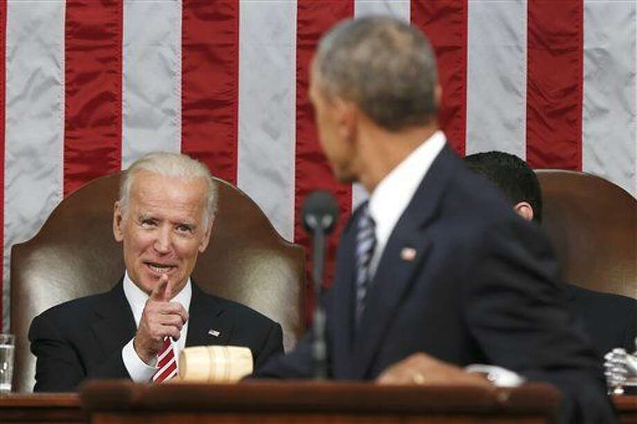 "FILE - In this Jan. 12, 2016 file-pool photo, Vice President Joe Biden points at President Barack Obama during the president's State of the Union address to a joint session of Congress on Capitol Hill in Washington. Harking back to America's triumphant race into space, the Obama administration is launching what it calls a ""moonshot"" effort to cure cancer. Don't expect miracles in the president's last months, but there has been striking progress in recent years. (AP Photo/Evan Vucci, Pool, File) Photo: Evan Vucci"