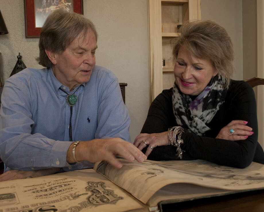 Wallace Craig and Carolyne Hobby talk about the historical map book of St. Louis he found in his grandparents home and shows some of the hand drawn map pages Friday, 1-16-15. Tim Fischer\Reporter-Telegram Photo: Tim Fischer