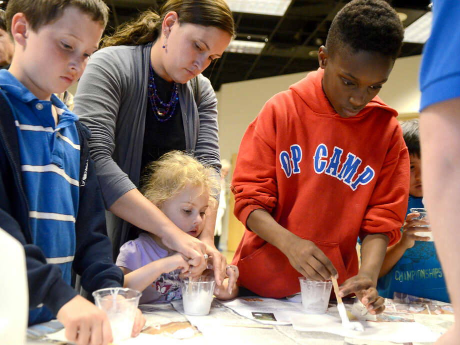 Children make homemade rubber during Family Science Night on Thursday at the Petroleum Museum. James Durbin/Reporter-Telegram Photo: JAMES DURBIN