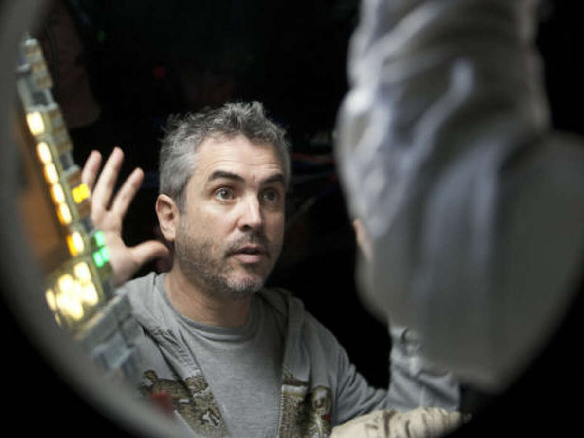 """Alfonso Cuarón - """"Gravity"""" (pictured above)Steve McQueen - """"12 Years A Slave""""Alexander Payne - """"Nebraska""""David O. Russell - """"American Hustle""""Martin Scorsese - """"The Wolf of Wall Street""""Nancy:Alfonso Cuarón. Now that it's no longer a lock for the film that wins best director to go on to win best picture, this should be Cuarón's year. """"Gravity is not only the biggest box-office draw out of the nominees, it's a real nail-biter that stands up under multiple viewings.Trevor: David O. Russell for """"American Hustle,"""" because I like alliteration.Tyler: The amount of work it took to make """"Gravity"""" a reality makes Alfonso Cuaron the deserving choice this year. He's a true visionary.Winner: Alfonso Cuarón - """"Gravity"""""""