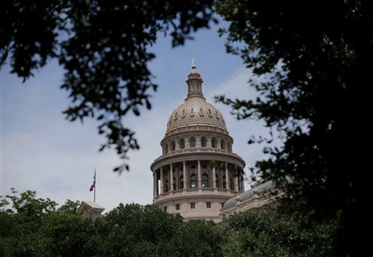 FILE - In This July 30, 2013, file photo, the dome of the Texas State Capital is seen through trees on the final day a special session in Austin.