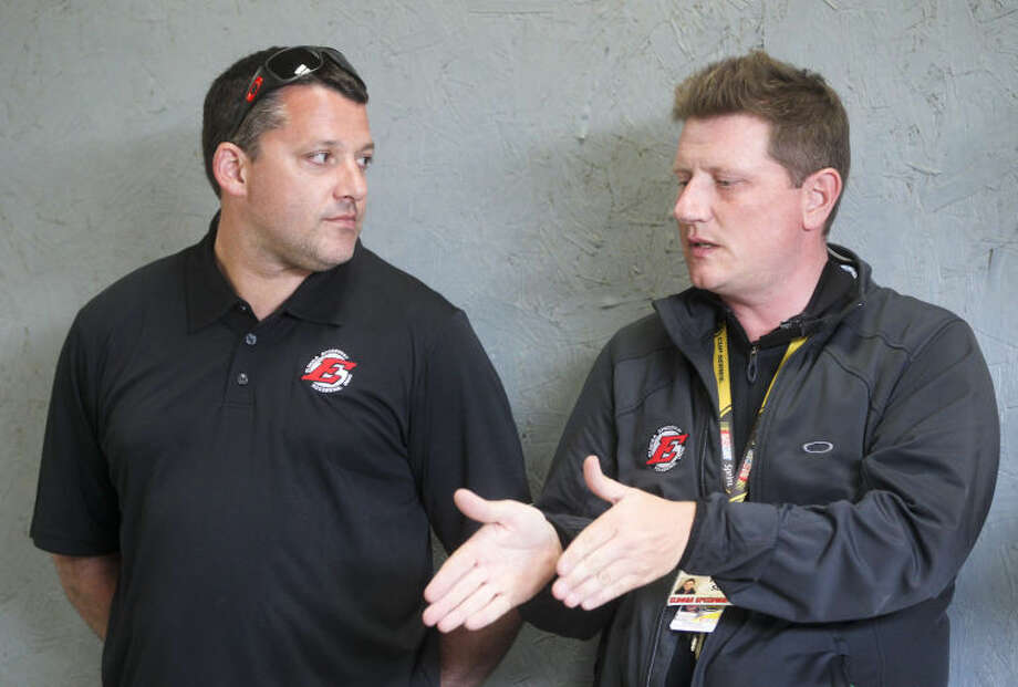 Eldora Speedway owner, and three-time NASCAR Sprint Cup champion Tony Stewart,left, talks with Eldora Speedway general manager Roger Slack before the inaugural Mudsummer Classic NASCAR Trucks Series race at Eldora Speedway, Wednesday, July 24, 2013, in Rossburg, Ohio. (AP Photo/The Dayton Daily News, Greg Lynch) LOCAL PRINT OUT; LOCAL TV OUT; WKEF-TV OUT; WRGT-TV OUT; WDTN-TV OUT Photo: Greg Lynch