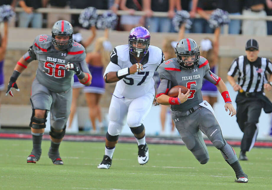 Texas Tech quarterback Baker Mayfield (6) goes for a big gain against the TCU defense in Thursday nights Big XII matchup at Jones AT & T stadium. Photo: Wade H Clay