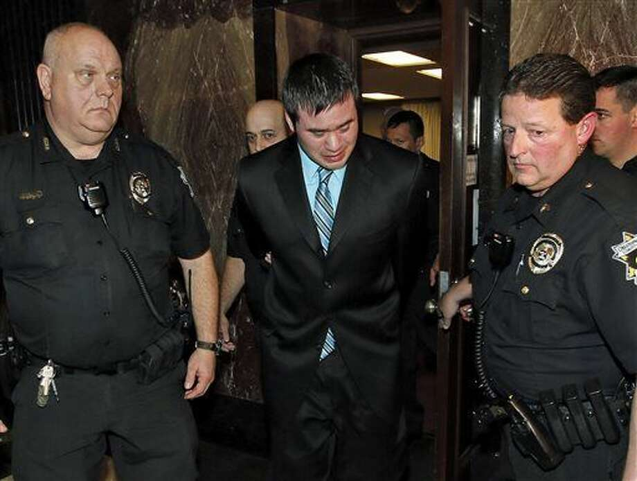 Former Oklahoma City police officer Daniel Holtzclaw, center, cries as he is led from the courtroom after the verdicts were read for the charges against him at the Oklahoma County Courthouse in Oklahoma City, Thursday, Dec. 10, 2015. Holtzclaw was convicted of raping and sexually victimizing eight women on his police beat in a minority, low-income neighborhood. (Nate Billings/The Oklahoman via AP) Photo: Nate Billings