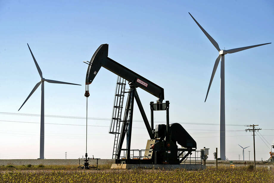 Wind turbines and oil pumpjack in action Tuesday, Oct. 27, 2015, north of Stanton, Texas. James Durbin/Reporter-Telegram