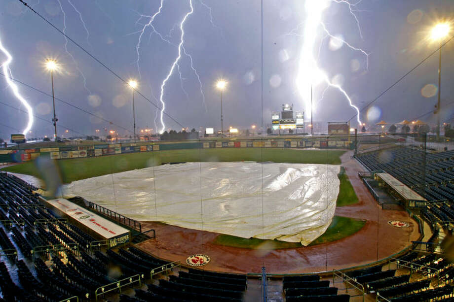 Lightning strikes over Citibank Ballpark during a storm that delayed the RockHounds vs San Antonio Missions game June 13, 2013. James Durbin/Reporter-Telegram Photo: JAMES DURBIN