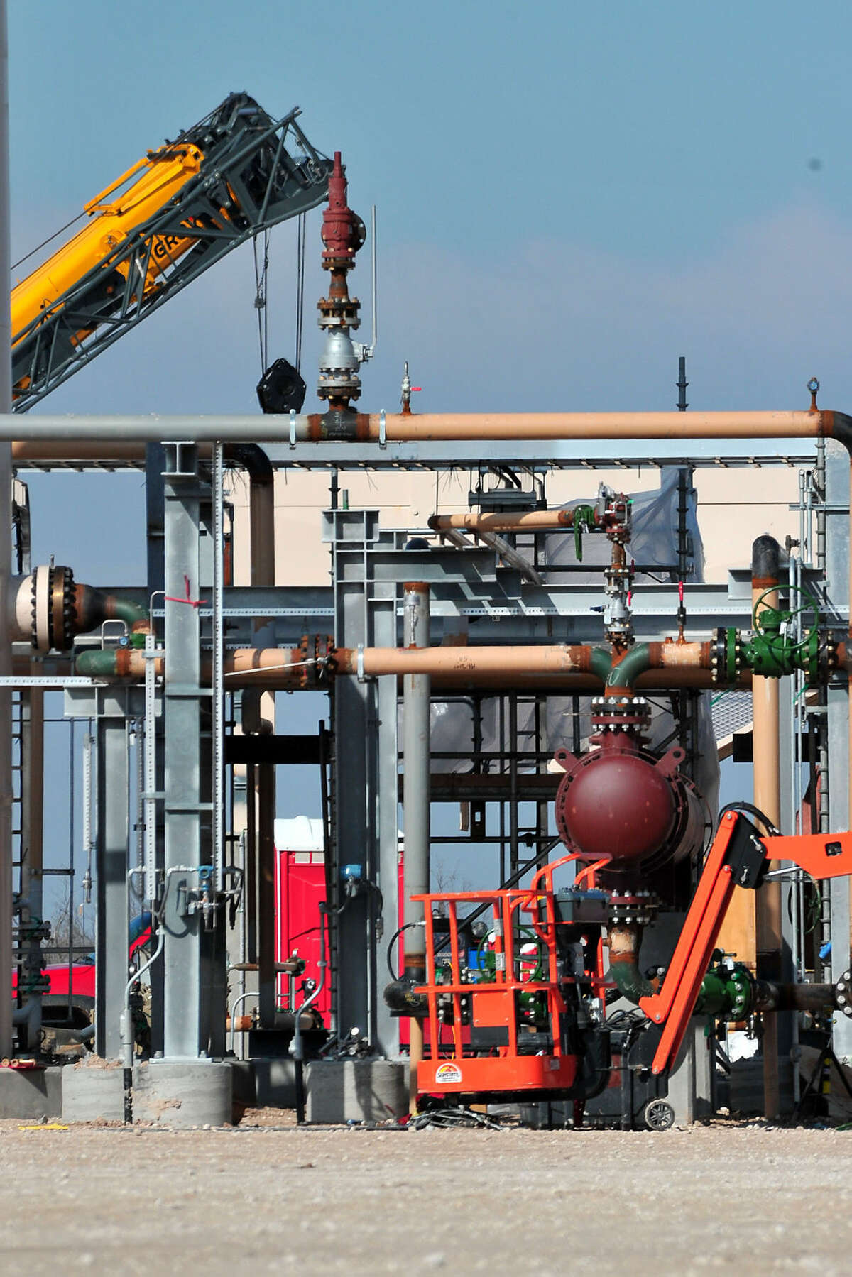 Kimberley Meyer/Special to the Houston Chronicle Work is underway to complete a new drilling site while other rigs are closing in Reagan County. Reagan County includes horizontal drilling rigs used for fracking to recover oil. These rigs provide jobs and money for Big Lake. Some Rigs in the area are closing due to the recent drop in price of oil.