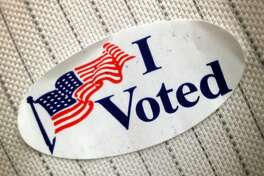 """An """"I Voted"""" sticker shown that was given to a voter at polling place Tuesday, Nov. 4, 2014, in Pearland. ( Melissa Phillip / Houston Chronicle )"""