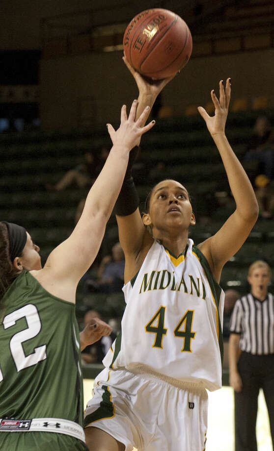 Midland College's Marielka Garate pulls up for a shot over Western Texas' Kendall Festervand Monday evening, 1-12-15, at the Chaparral Center. Tim Fischer\Reporter-Telegram Photo: Tim Fischer