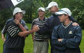 California golf coach Steve Desimone, second from right, congratulates his team as they celebrate after winning the NCAA Division I men's championship Friday, June 4, 2004, in Hot Springs, Va. (AP Photo/The Roanoke Times, Seth M. Gitner)  ProductNameChronicle   ProductNameChronicle   ProductNameChronicle