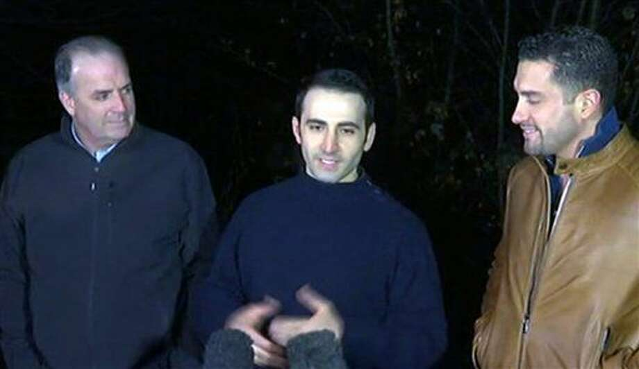 In this image made from video, former U.S Marine Amir Hekmati, center, is flanked by Michigan congressman Dan Kildee, left, and Hekmati's brother-in-law Ramy Kurdi as he speaks to the media in Landstuhl, Germany, Tuesday, Jan. 19, 2016. Former U.S. Marine Amir Hekmati, who was one of four Americans released by Iran as part of a prisoner swap, is in good health and looking forward to getting home soon, a congressman said Tuesday. U.S. Rep. Dan Kildee, a Democrat from Hekmati's home state of Michigan, said he spent several hours with the 32-year-old, who spent 4 ½ years imprisoned in Iran before his release over the weekend. (APTN via AP) Photo: TEL