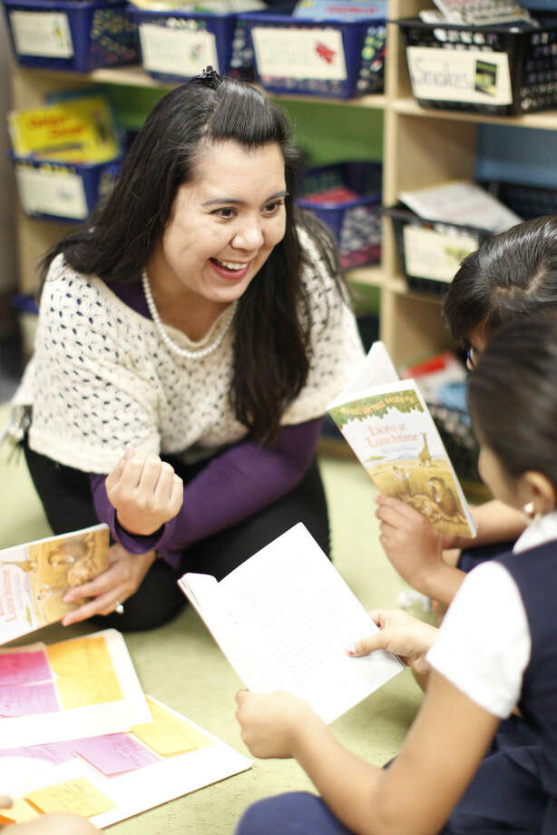 "Adalina Torres-Borrego, third-grade teacher at Henderson Elementary.""I believe that being a teacher means that you are a lifelong learner. There are always new ways and more creative ways to teach. I love bringing my lessons 'to life' for my students. By creating experiences for them, they are able to connect to the lessons being taught. I am a strong believer in cooperative learning."" Photo: James Durbin"