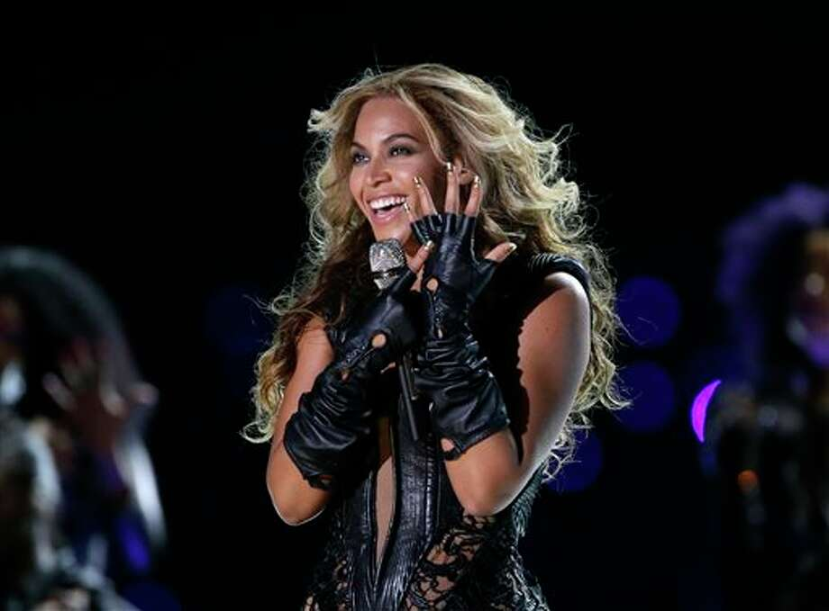 "FILE - In this Feb. 3, 2013 file photo, Beyonce performs during the Pepsi Super Bowl XLVII Halftime Show football game between the San Francisco 49ers and the Baltimore Ravens, in New Orleans. Beyonce stopped short of apologizing for using a sample of audio from the Space Shuttle Challenger explosion in a statement released on Tuesday, Dec. 31, 2013, to ABC. The pop superstar explained the use of the short snippet at the beginning of her song ""XO"" from her new self-titled album after it brought criticism from the wife of the commander at the helm of the Challenger when it exploded in 1986 and others. (AP Photo/Mark Humphrey, File) Photo: Mark Humphrey / AP"