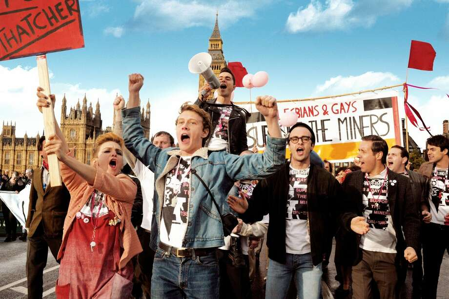 "Front row, left to right: Faye Marsay as Steph, George Mackay as Joe, Joseph Gilgun as Mike, Paddy Considine as Dai and, second row, with megaphone, Ben Schnetzer as Mark in ""Pride."" (Photo courtesy CBS Films/MCT) Photo: Handout"